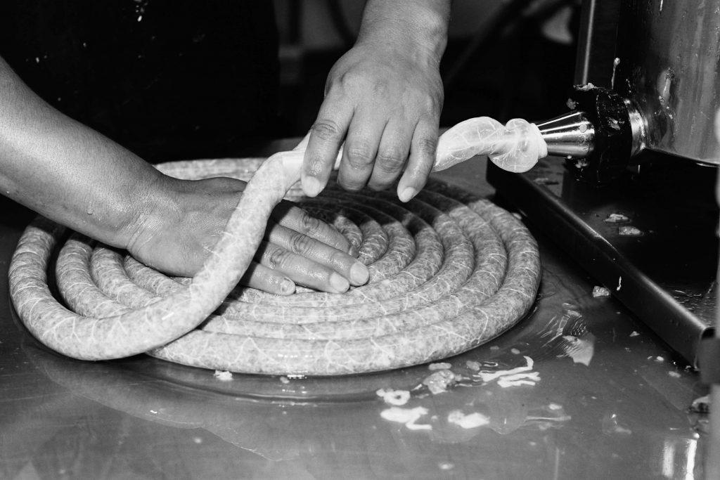 Pine Street Market stuffing sausage
